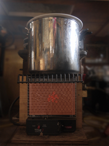 Heater with pot of water above it