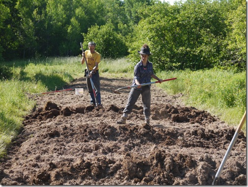 Meagan and Sylvain working the soil
